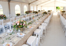white wedding tent with tables and chairs
